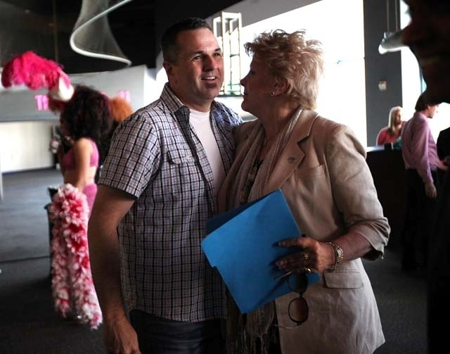 Krave Entertainment owner Kelly Murphy and Mayor Carolyn Goodman embrace during a July 25 news conference at Neonopolis. (Las Vegas Review-Journal/File)