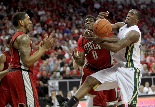 UNLV's Savon Goodman battles for the ball against Greg Smith of Colorado State in the first half of their Mountain West Conference tournament semifinal at the Thomas & Mack Center in March 2013.