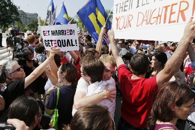 Supporters of gay marriage embrace on June 26 outside the Supreme Court in Washington after the court struck down a provision of a federal law denying federal benefits to married gay couples and c ...