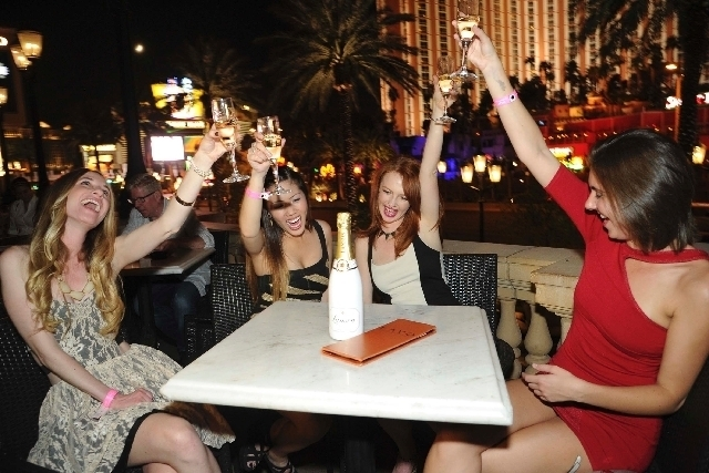 Women toast the night on Lavo's terrace at the first World's Largest Bachelorette Party in 2012.