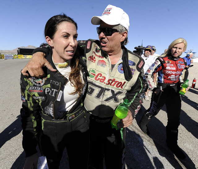 NHRA Funny Car drivers John Force and Alexis DeJoria chat with each other after Force defeated DeJoria in the third round of eliminations of the NHRA Funny Car championship Sunday at the Las Vegas ...