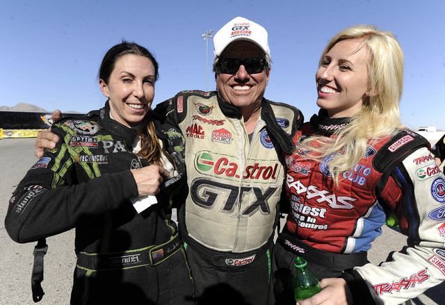 NHRA Funny Car drivers John Force, daughter Courtney, (right) and Alexis DeJoria chat with each other after John defeated DeJoria in the third round of eliminations of the Toyota Nationals at The  ...
