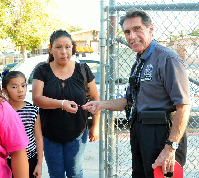 North Las Vegas' Volunteers in Police Services Citizen's Patrol founder Richard Cherchio greets residents at a National Night Out public safety event Aug. 6 at Hartke Park, 1900 E. Tonopah Ave. Ch ...
