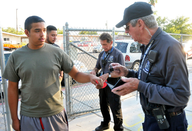 North Las Vegas' Volunteers in Police Services Citizen's Patrol volunteer Phil Armstrong greets residents at North Las Vegas' National Night Out public safety event Aug. 6 at Hartke Park, 1900 E.  ...