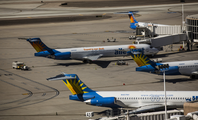 Allegiant Travel Company airplanes as seen Tuesday, Oct. 22, 2013 at Terminal 1 A Gate at McCarran International Airport. (Jeff Scheid/Las Vegas Review-Journal)