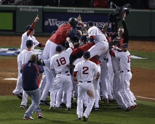 The Boston Red Sox celebrate after defeating the St. Louis Cardinals in Game 6 of baseball's World Series Wednesday, Oct. 30, 2013, in Boston. The Red Sox won 6-1 to win the series. (AP Photo/Char ...