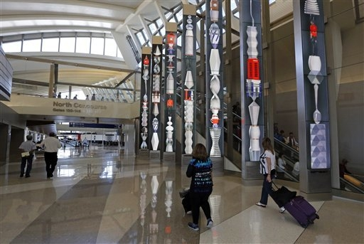 The Tom Bradley International Terminal is seen at Los Angeles International Airport in this file photo. (AP Photo/Reed Saxon)