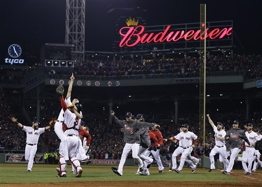 Boston Red Sox relief pitcher Koji Uehara and catcher David Ross celebrate after getting St. Louis Cardinals' Matt Carpenter to strike out and end Game 6 of baseball's World Series Wednesday, Oct. ...