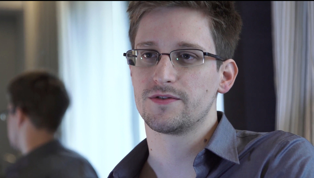 This photo provided by The Guardian Newspaper in London shows Edward Snowden, who worked as a contract employee at the National Security Agency, on Sunday, June 9, 2013, in Hong Kong. (AP Photo/Th ...