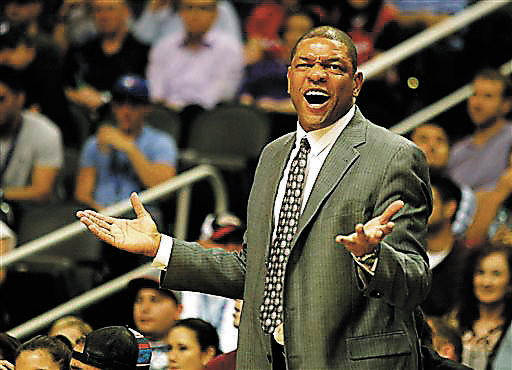 Los Angeles Clippers head coach Doc Rivers reacts to a call in the first quarter of an NBA preseason basketball game against the Phoenix Suns on Tuesday, Oct. 15, 2013, in Phoenix. (AP Photo/Rick  ...