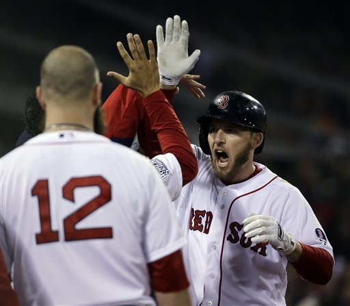 Boston Red Sox's Stephen Drew is congratulated after hitting a home run during the fourth inning of Game 6 of baseball's World Series against the St. Louis Cardinals Wednesday, Oct. 30, 2013, in B ...