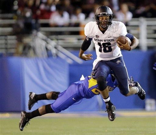 Utah State quarterback Chuckie Keeton (16) runs past San Jose State cornerback Chris Hill during the second half of an NCAA college football game on Friday, Sept. 27, 2013, in San Jose, Calif. (AP ...