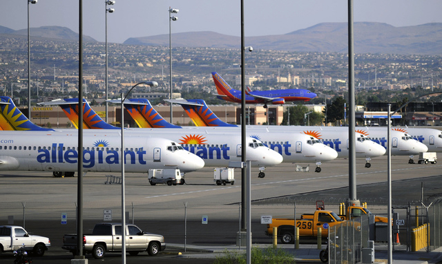 Allegiant Air jets are parked at McCarran International Airport in Las Vegas in this May 9, 2013, file photo. (File, David Becker/The Associated Press)