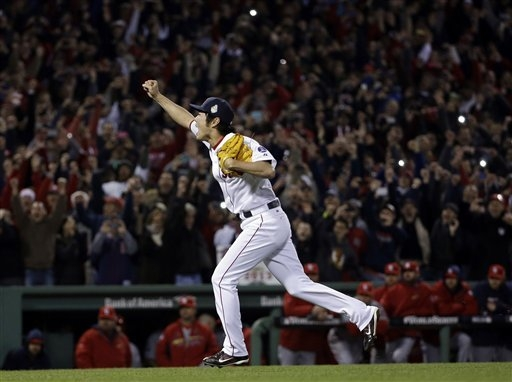 Boston Red Sox relief pitcher Koji Uehara reacts after getting St. Louis Cardinals' Matt Carpenter to strike out and end Game 6 of baseball's World Series Wednesday, Oct. 30, 2013, in Boston. The  ...