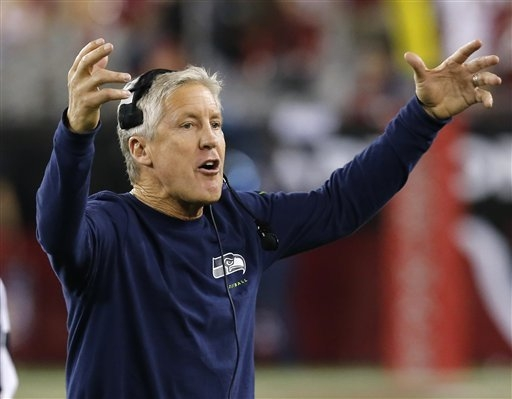 Seattle Seahawks head coach Pete Carroll yells during the first half of a game against the Arizona Cardinals. (AP Photo/Ross D. Franklin)