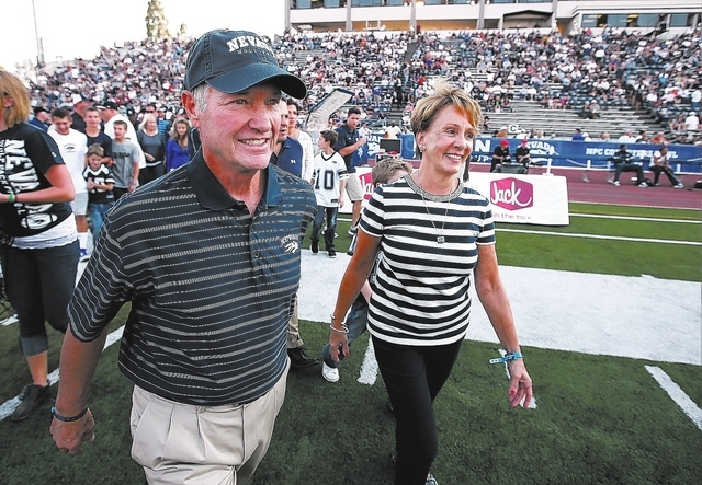 Former Nevada head coach Chris Ault and his wife Kathy enter the field for a pre-game ceremony to rename Mackay Stadium as Chris Ault Field before a college football game between UC Davis and Neva ...