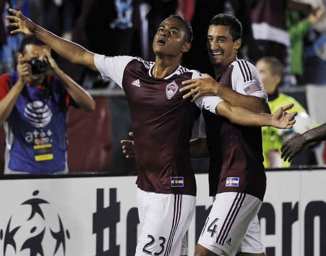 Colorado Rapids' Jaime Castrillon, left, celebrates his goal to tie the score with Tony Cascio against Real Salt Lake in the second half of the 2-2 tie in a MLS soccer game in Commerce City, Colo. ...