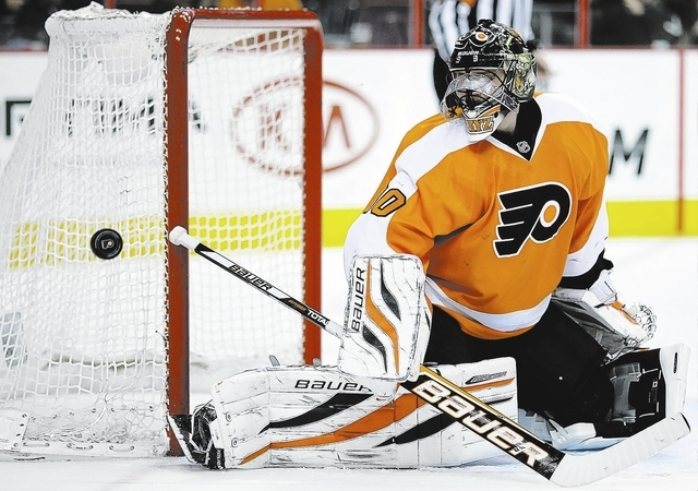 Philadelphia Flyers' Ilya Bryzgalov, of Russia, blocks a shot in the first period of an NHL hockey game against the New York Islanders, Thursday, April 25, 2013, in Philadelphia. (AP Photo/Matt Sl ...