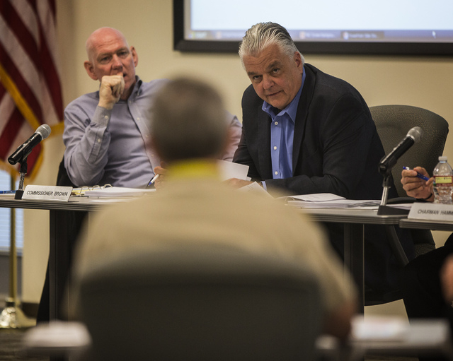 Clark County Commissioner Larry Brown, left, and Steve Sisolak as seen during Metro's Fiscal Affairs Committee  Monday, Oct. 28, 2013, at Metro Headquarters, 400 S. Martin Luther King Boulevard. I ...