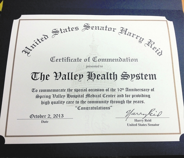 Spring Valley Hospital, 5400 S. Rainbow Blvd., in Las Vegas, receives a certificate of commendation from Sen. Harry Reid on Oct. 2, 2013. The hospital recently celebrated its 10th anniversary. (Ca ...