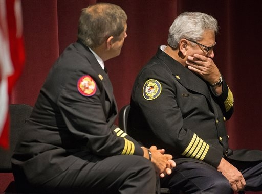 Dan Fraijo, Prescott Fire Chief, right, and Darrell Willis , Prescott Fire Department Woodland Division Chief , listen to a video during a press conference at Prescott High School Saturday Sept. 2 ...