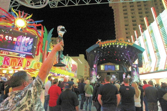 Rob Morris of grand Rapids, Mich., drinks at the Fremont Street Experience Friday, Oct. 4, 2013. More than 1,300 open container violations have been tossed from the Municipal Court system after La ...