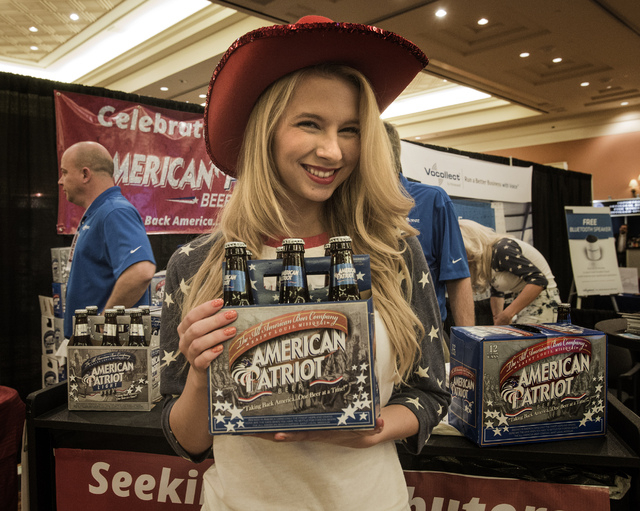 Tylor Simpson at the American Patriot beer booth during the National Beer Wholesalers Association Convention and Trade show at Caesars Palace on Tuesday, Oct. 1, 2013. The 76th annual event for be ...