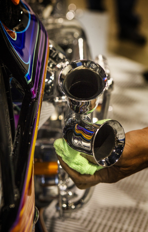 Las Vegas motorcycle builder Paul Ponkow polishes Black Rainbow  during BikeFest at Cashman Center, Wednesday, Oct. 3, 2013. More than 200 vendors and 35,000 people are expected to attend the four ...