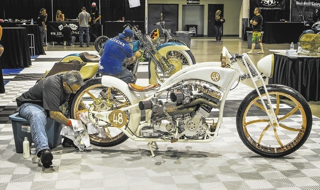 Bobby James of King of Shine Specialized Detailing polishes a motorcycle built by Ron Harris Cop Docs Chopper during BikeFest at Cashman Center, Wednesday, Oct. 3, 2013.  It took him over six hour ...