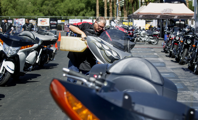 Steve Tucker fuels a Victory Motorcycle during BikeFest at Cashman Center, Wednesday, Oct. 3, 2013. More than 200 vendors and 35,000 people are expected to attend the four day event. (Jeff Scheid/ ...