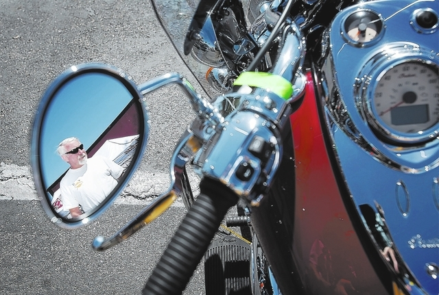 Tom Fabio looks at an Indian Chief Vintage motorcycle during BikeFest at Cashman Center, Wednesday, Oct. 3, 2013. The bike retails for $20,999. More than 200 vendors and 35,000 people are expected ...
