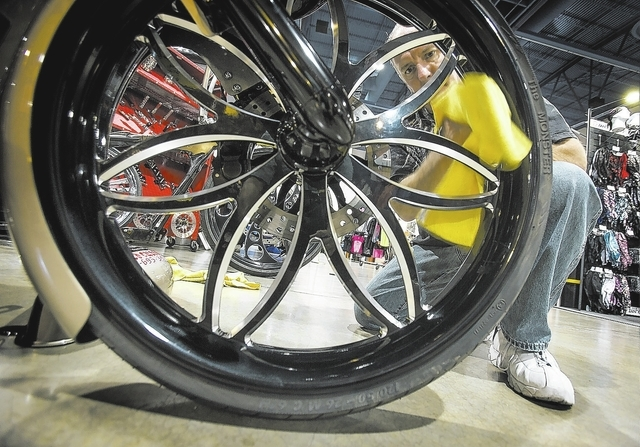 Bill Nethercutt from Phoenix, Ariz. polishes the wheel of his Harley-Davidson Roadglide motorcycle  during BikeFest at Cashman Center, Wednesday, Oct. 3, 2013. More than 200 vendors and 35,000 peo ...