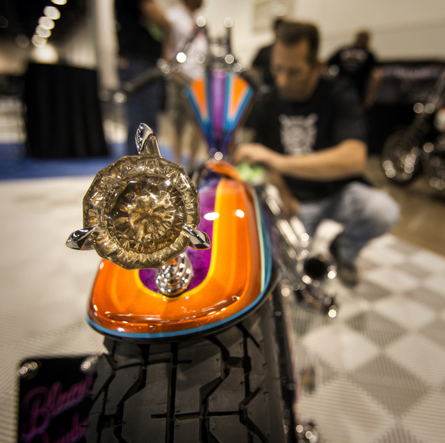 Ron Besserer polishes Black Rainbow custom motorcycle during BikeFest at Cashman Center, Wednesday, Oct. 3, 2013. More than 200 vendors and 35,000 people are expected to attend the four day event. ...