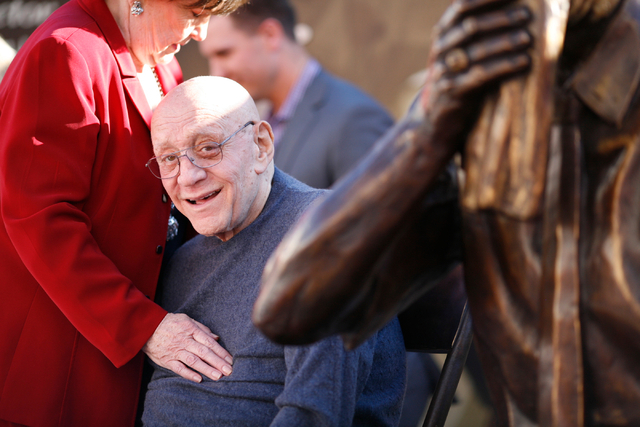 Jerry Tarkanian sits with his likeness and his wife Lois after the unveiling of his statue at UNLV's Thomas & Mack Center outdoor plaza on Wednesday Oct. 30, 2013. (Alex Federowicz/Las Vegas Revie ...