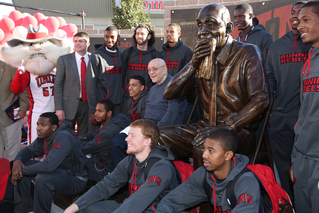Jerry Tarkanian poses for pictures surrounded by current UNLV coach, Dave Rice, and his team at the unveiling of the Jerry Tarkanian statue at UNLV's Thomas & Mack Center outdoor plaza on Wednesda ...