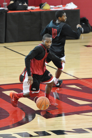 UNLV junior Deville Smith dribbles the ball during a practice on campus at the Mendenhall Center in Las Vegas Monday, Oct. 7, 2013. (David Cleveland/Las Vegas Review-Journal)