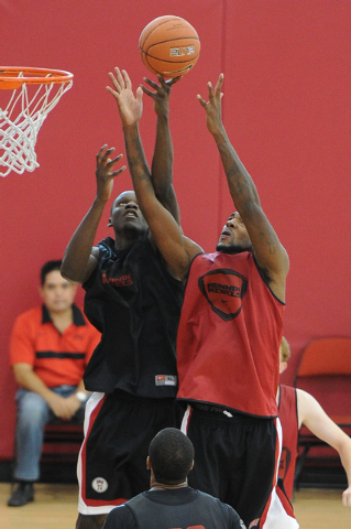 UNLV junior Roscoe Smith, right, fights for a rebound against Demetris Morant during a practice on campus at the Mendenhall Center in Las Vegas Monday, Oct. 7, 2013. (David Cleveland/Las Vegas Rev ...