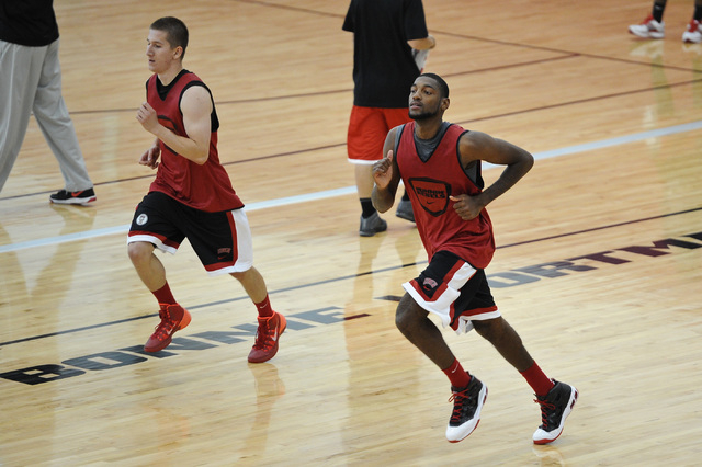 UNLV junior Roscoe Smith, right, runs during a practice on campus at the Mendenhall Center in Las Vegas Monday, Oct. 7, 2013. (David Cleveland/Las Vegas Review-Journal)