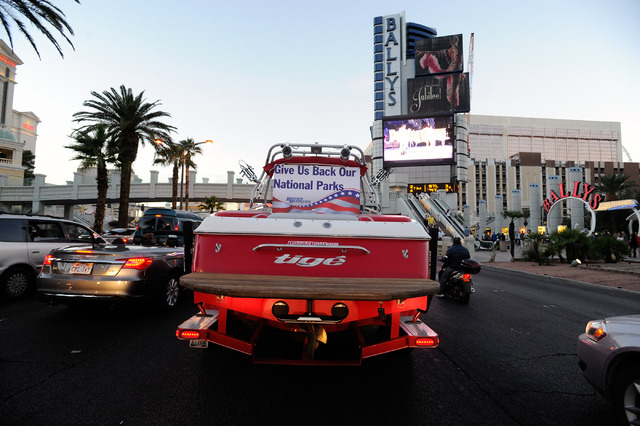 A boat is towed up the Las Vegas Strip protesting the closure of the Lake Mead National Recreation Area on Sunday, Oct. 6, 2013.  Several dozen boaters joined together to Ұeacefully cruise&# ...