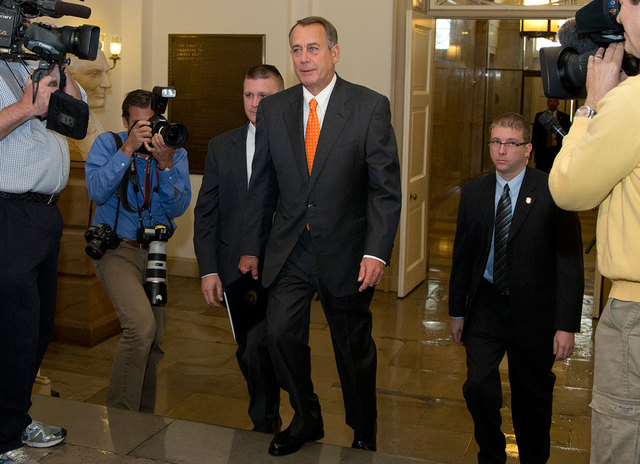House Speaker John Boehner of Ohio arrives on Capitol Hill on Wednesday. Chaos among Republicans in the House of Representatives has left it to bipartisan leaders in the Senate to craft a last-min ...