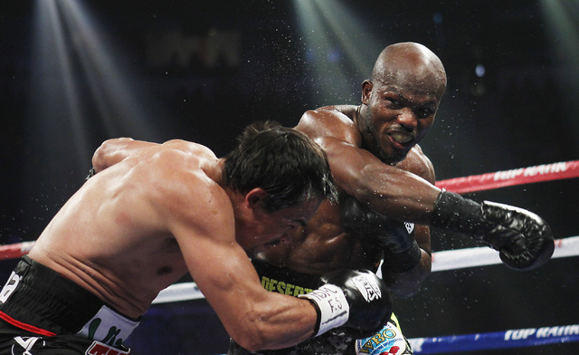 Tim Bradley, right, pounds on Juan Manuel Marquez during their WBO Welterweight Title fight at the Thomas & Mack Center in Las Vegas on Oct. 12, 2013.  Bradley won by split decision. (Jason Bean/L ...