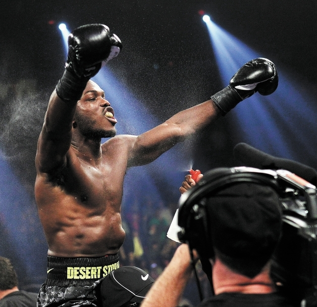 Tim Bradley celebrates his victory over Juan Manuel Marquez after their WBO Welterweight Title fight at the Thomas & Mack Center in Las Vegas on Oct. 12, 2013.  Bradley won by split decision. (Jas ...