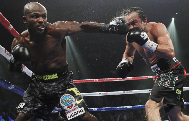 Tim Bradley, left, lands a blow against Juan Manuel Marquez during their WBO Welterweight Title fight at the Thomas & Mack Center in Las Vegas on Oct. 12, 2013.  Bradley won by split decision. (Ja ...