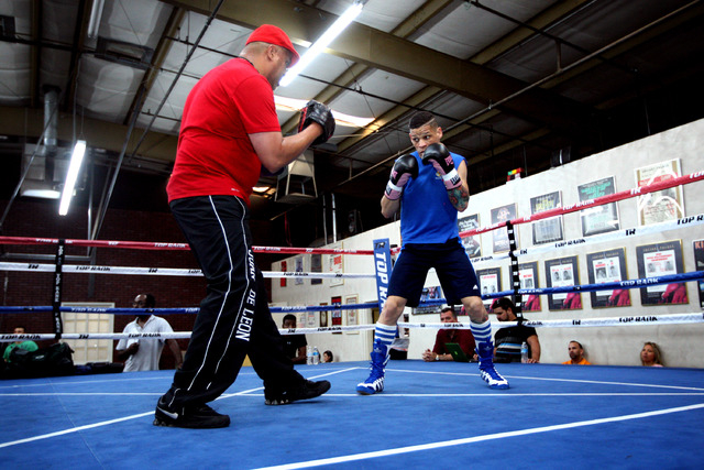 Featherweight boxer Orlando Cruz, right, works out with trainer Juan De Leon at Top Rank Gym in Las Vegas on Monday, preparing for his fight Saturday at the Thomas & Mack Center.  (Jessica Ebelhar ...