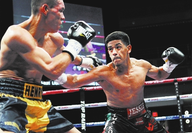 Jessie Magdaleno, right, takes on Henry Maldonado during their super bantamweight fight at the Joint in the Hard Rock Hotel & Casino in Las Vegas on June 8, 2013. (Jason Bean/Las Vegas Review-Journal)