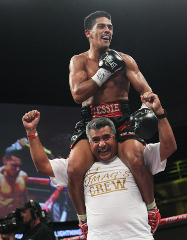 Jessie Magdaleno celebrates with his father Jesus after defeating Henry Maldonado during their super bantamweight fight at the Joint in the Hard Rock Hotel & Casino in Las Vegas on June 8, 2013. ( ...