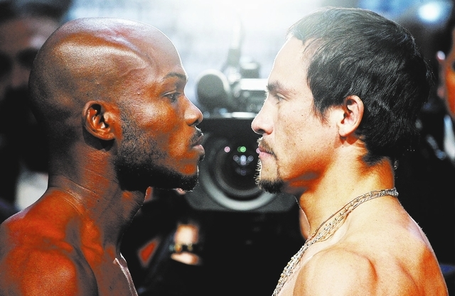 Boxers Juan Manuel Marquez, right, and Timothy Bradley face off prior to their World Welterweight Championship fight at the Wynn Las Vegas on Oct. 11, 2013. (Jason Bean/Las Vegas Review-Journal)