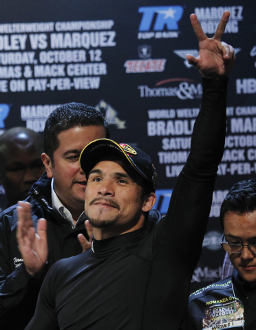Boxer Juan Manuel Marquez acknowledges the crowd during the weigh in prior to his World Welterweight Championship fight  against Timothy Bradley at the Wynn Las Vegas on Oct. 11, 2013. (Jason Bean ...