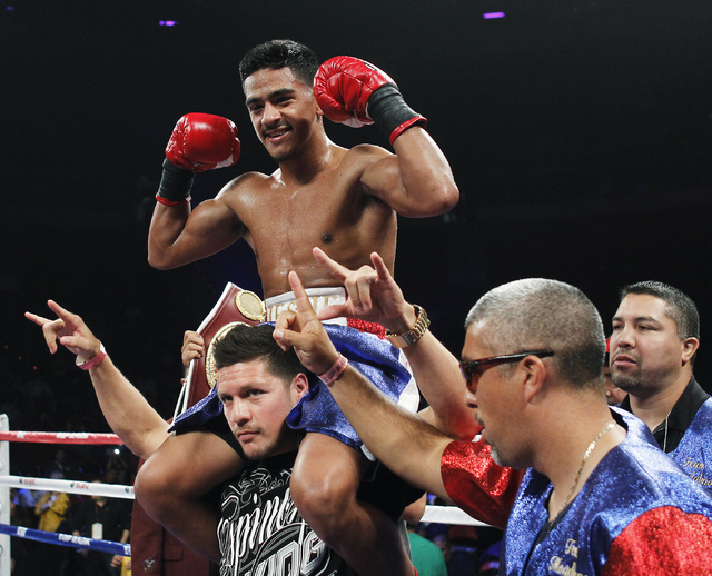 Jessie Magdaleno celebrates his victory over Raul Hidalgo during their Super Bantamweight fight at the Thomas & Mack Center in Las Vegas on Oct. 11, 2013. Magdaleno won by TKO in the third round.  ...