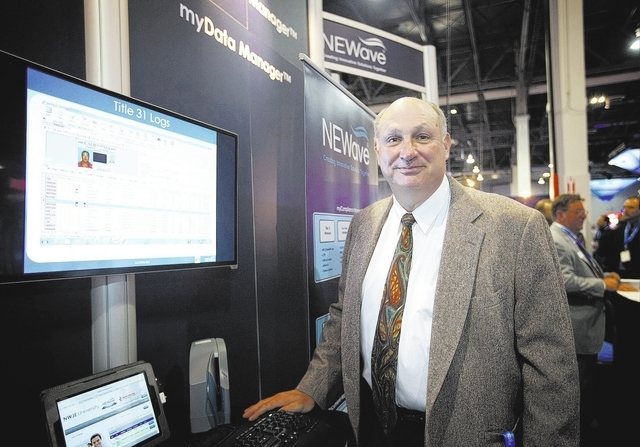 Jim Bach, co-founder of Las Vegas-based NEWave Inc. is seen at the company booth at the G2E convention in Las Vegas Tuesday, Sep. 24, 2013. (Jessica Ebelhar/Las Vegas Review-Journal)